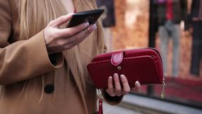 Elegant woman`s hand opening red purse outdoors stock video footage