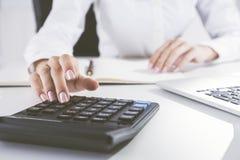 Elegant woman's hand is using calculator Stock Photos
