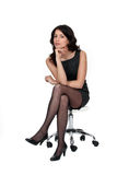 Elegant woman. Sat on an armchair Stock Image