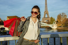Elegant woman with shopping bags looking into distance in Paris Royalty Free Stock Photos