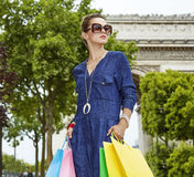 Elegant woman with shopping bags looking into distance in Paris Royalty Free Stock Images