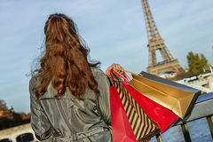 Elegant woman with shopping bags looking on Eiffel tower, Paris Stock Image