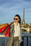 Elegant woman with shopping bags in Paris looking into distance Royalty Free Stock Photo