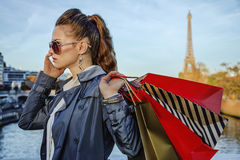 Elegant woman with shopping bags speaking on mobile phone, Paris Stock Photos