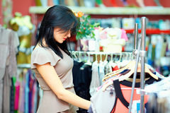Elegant woman shopping in clothes store Stock Image