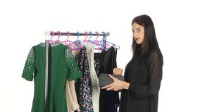 Elegant woman shopping in clothes store. White stock video