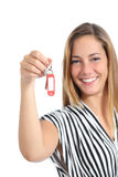 Elegant woman showing her new home keys. Isolated on a white background Royalty Free Stock Photography