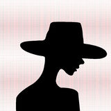 Elegant woman silhouette. Woman with hat Royalty Free Stock Photography