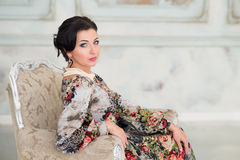 Elegant woman sitting on chair. Luxury Royalty Free Stock Photo