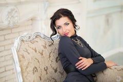 Elegant woman sitting on chair. Luxury Royalty Free Stock Photos
