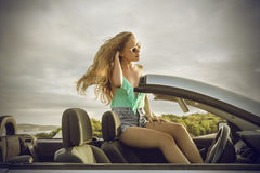 Elegant woman sitting in a classy car Royalty Free Stock Image