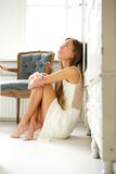 Elegant woman sitting on floor at home Stock Photo