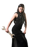 The elegant woman  with a spanner Stock Photo
