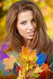 Elegant woman standing in a park in autumn Royalty Free Stock Photos