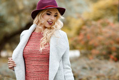 Elegant woman standing in a park in autumn Stock Photography