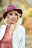Elegant woman standing in a park in autumn Royalty Free Stock Photography