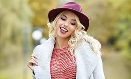 Elegant woman standing in a park in autumn Stock Image