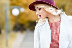 Elegant woman standing in a park in autumn Stock Images