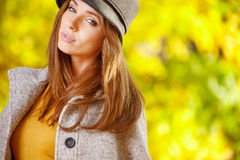 Elegant   woman standing in a park in autumn Royalty Free Stock Photo