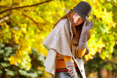 Elegant   woman standing in a park in autumn Stock Photos