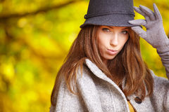 Elegant   woman standing in a park in autumn Royalty Free Stock Images