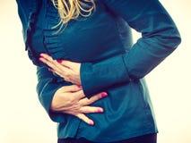 Elegant woman with stomach ache Stock Photo