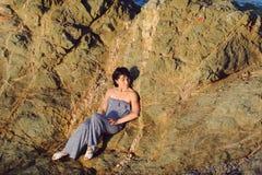 Elegant Woman on Stone Royalty Free Stock Photos