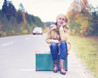 Elegant woman with a suitcase traveling Stock Photo