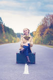 Elegant woman with a suitcase traveling Royalty Free Stock Photos