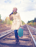 Elegant woman with a suitcase traveling by rail Royalty Free Stock Photo