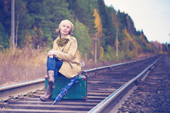 Elegant woman with a suitcase traveling by rail Stock Photo