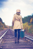 Elegant woman with a suitcase traveling by rail Royalty Free Stock Photos
