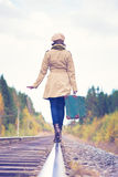 Elegant woman with a suitcase traveling by rail Royalty Free Stock Image