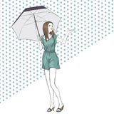 Elegant woman in summer dress with umbrella at full length Stock Photo