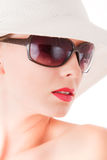 Elegant woman with sun glasses and white hat Stock Images
