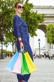 Elegant woman in sunglasses with shopping bags on Champ Elysees Royalty Free Stock Photos