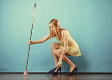 Elegant woman sweeping floor with broom Royalty Free Stock Photos