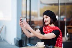 Elegant woman taking selfie outside Royalty Free Stock Photos