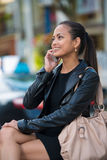 Elegant woman talking on smart phone Stock Image