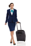 Elegant Woman With Trolley Cabin Bag Walking Towards Camera Stock Image