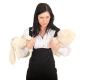 Elegant woman with two plush toys Stock Images