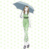 Elegant woman with umbrella at full length in summer Stock Photo