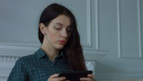 Elegant woman using digital tablet in domestic room stock video footage