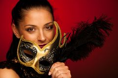 Elegant woman with venice mask over stilish red background - car. Nival Royalty Free Stock Photos