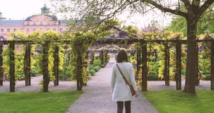 Elegant woman visiting German garden and castle stock footage