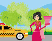 Elegant woman waiting for a taxi Royalty Free Stock Image