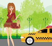 Elegant woman waiting for a taxi Royalty Free Stock Photos