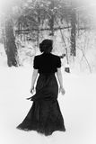 Elegant Woman Walking in Snow Royalty Free Stock Photos