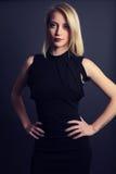 Elegant woman wearing a black dress Royalty Free Stock Photography