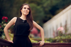 Elegant Woman Wearing Black Dress Standing in a Patio Stock Photography
